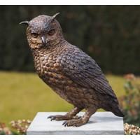 Uilsilhouet in brons