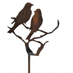 silhouet vogels op een boom in metaal